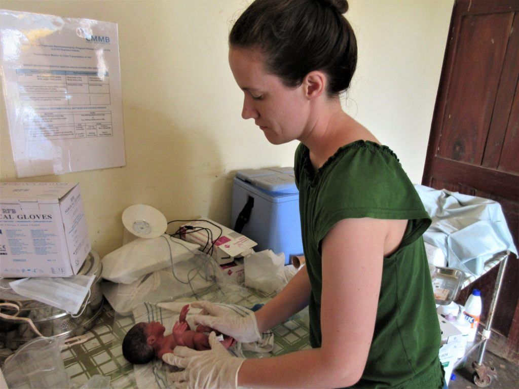 Sarah rubino carefully cares for a small newborn baby