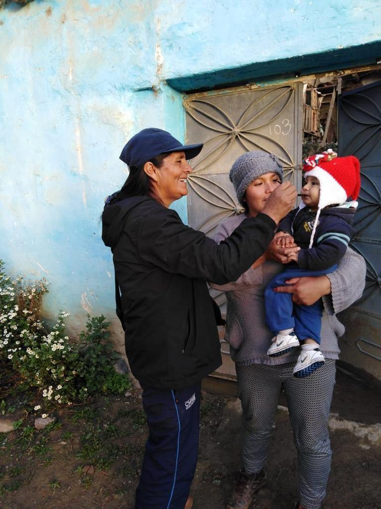 A community health promoter during iron supplementation in La Esperanza