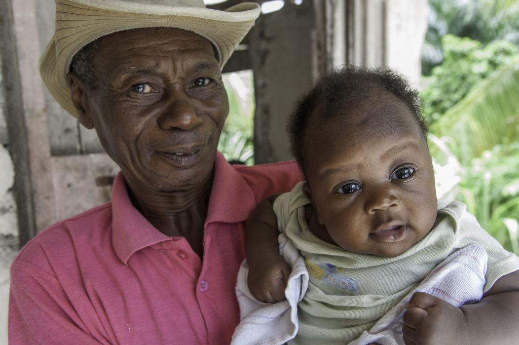 A dad holding his baby in Kenya