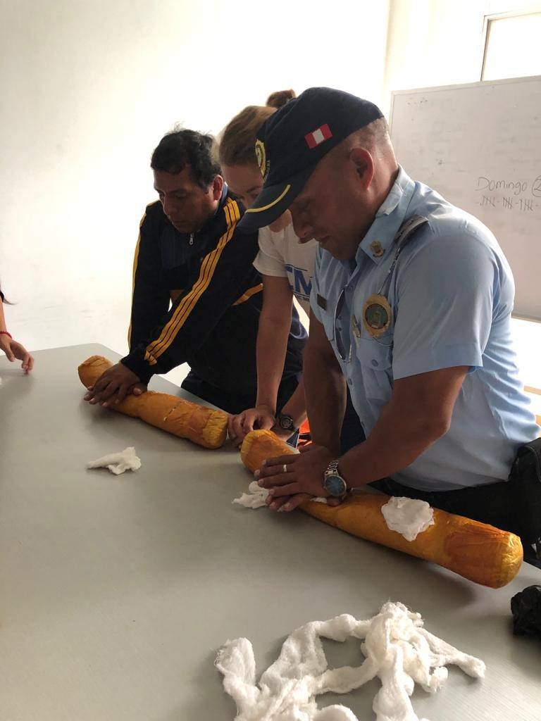 Police officers being trained in CPR in Peru