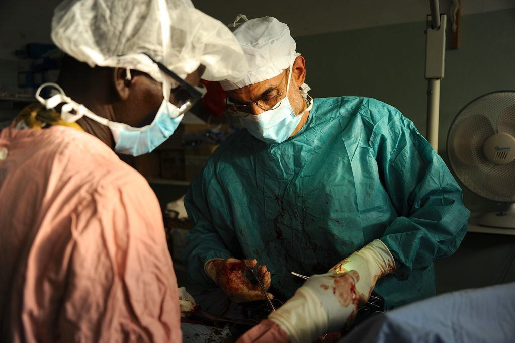 Dr. Tom performing surgery in the Nuba Mountains