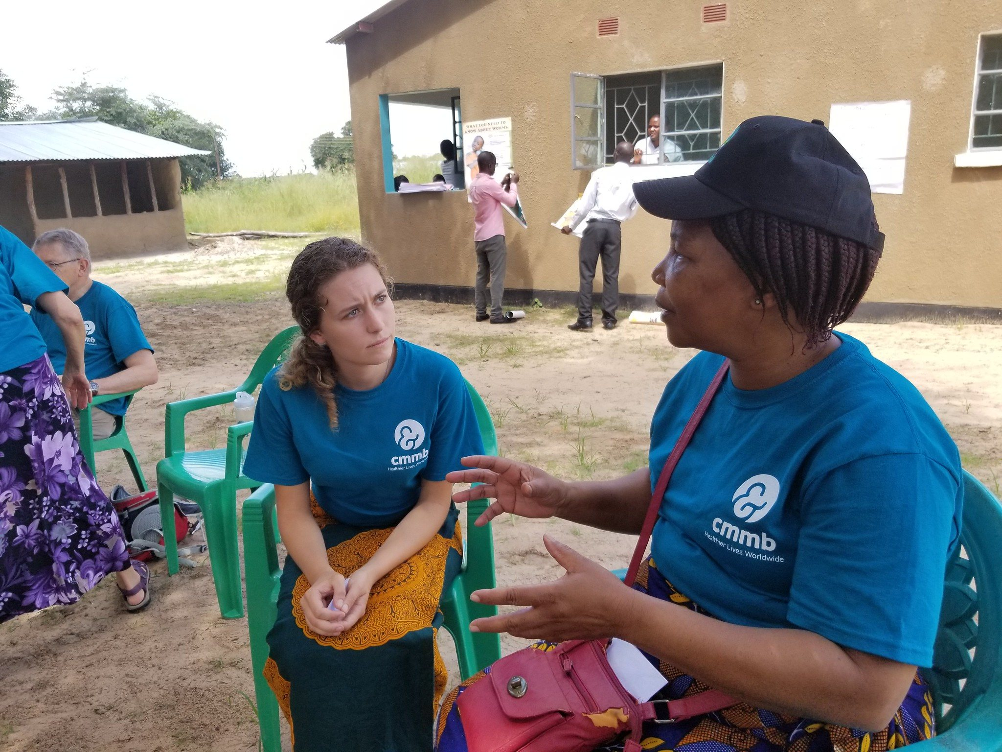 Rose with a community health worker