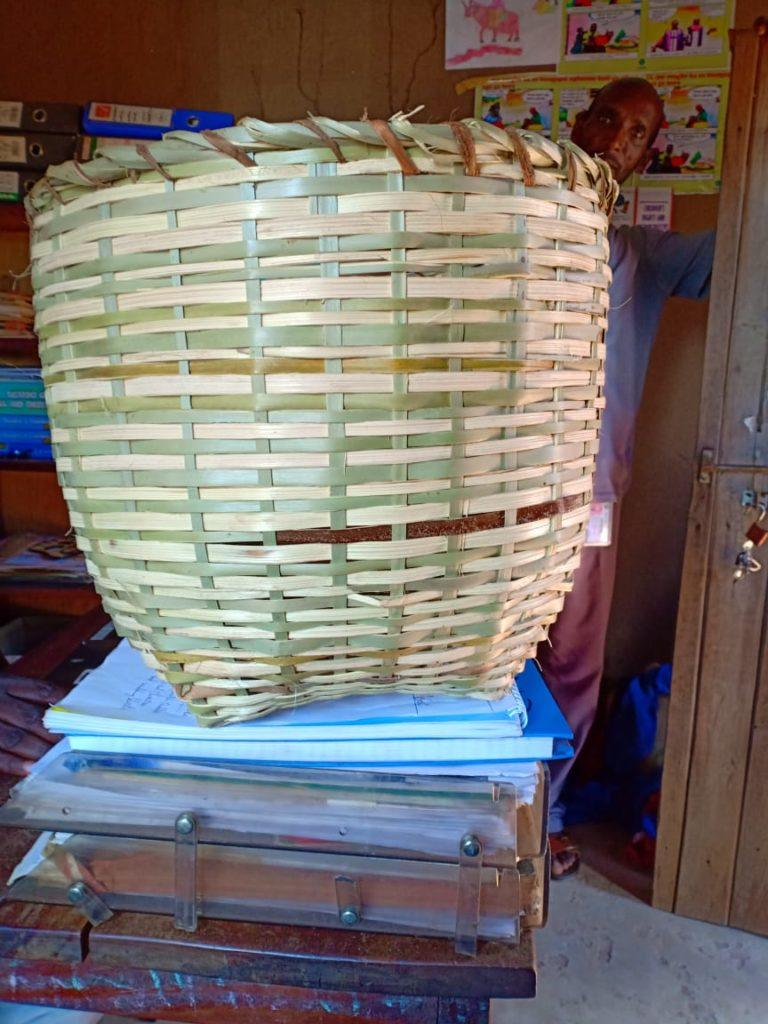 A basket on top of a desk. It was made by youth in South Sudan.