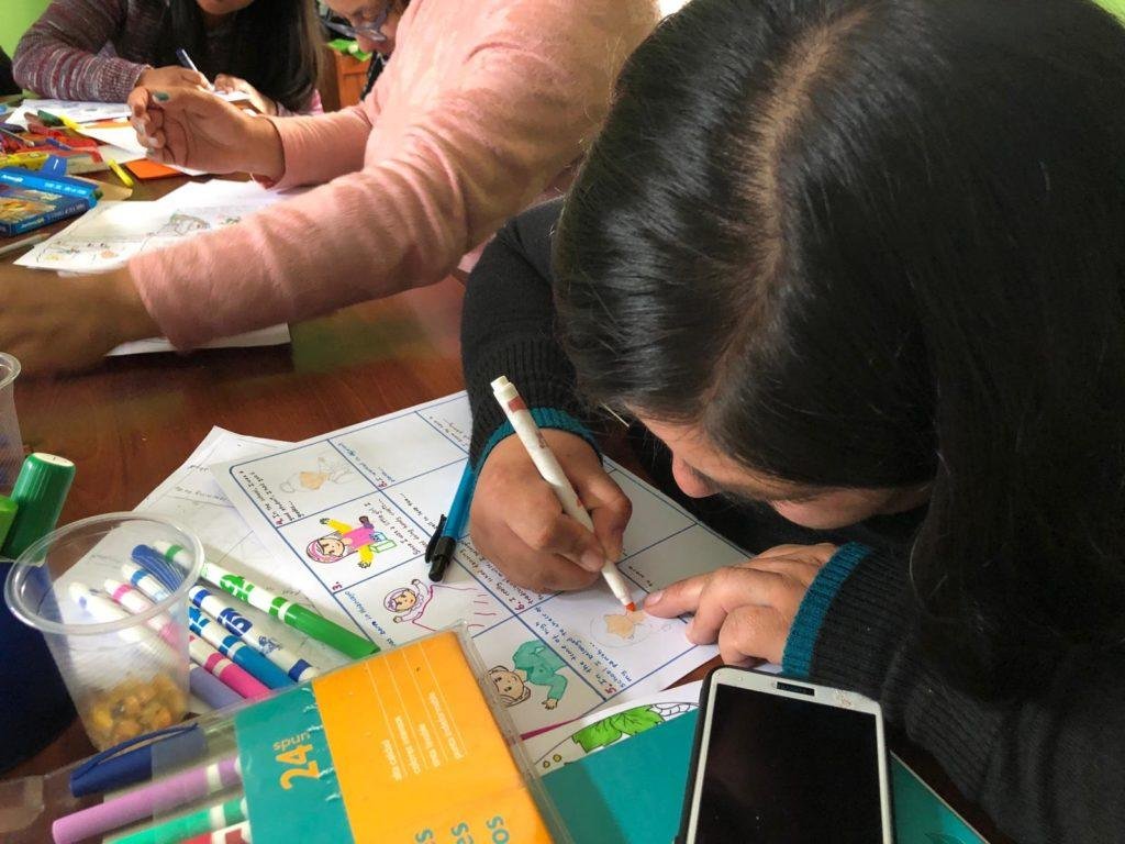 A woman in Peru completes an English worksheet