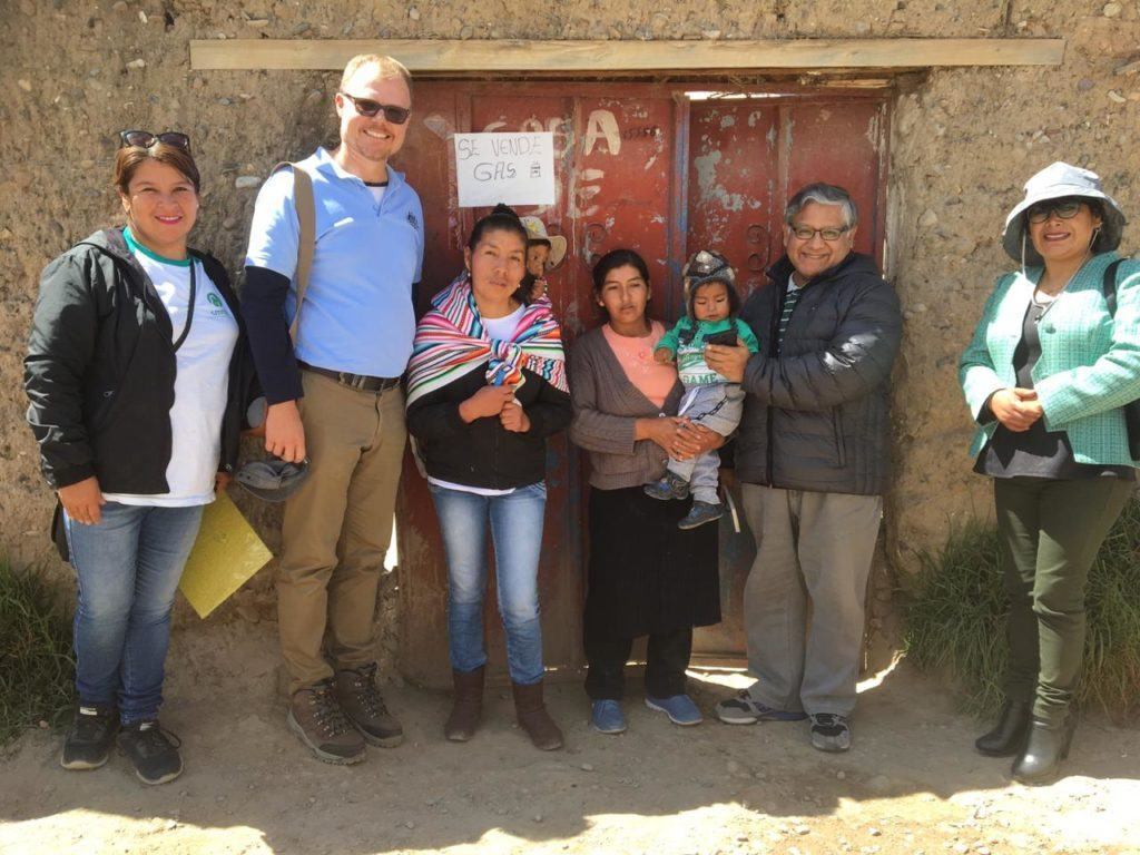 Australian Embassy visits Peru. Visitors stand with women leaders and CMMB Peru coordinators