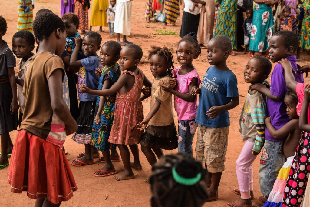 Children stand in lines playing games at child friendly spaces in South Suda