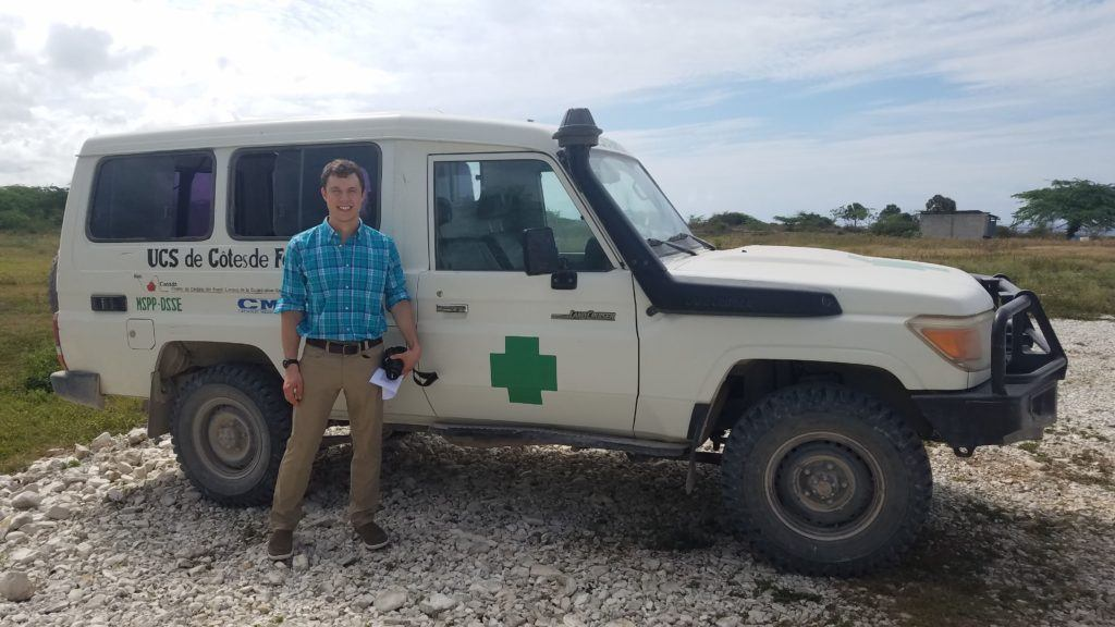 Dr. Zach stands in front of an ambulance in Haiti