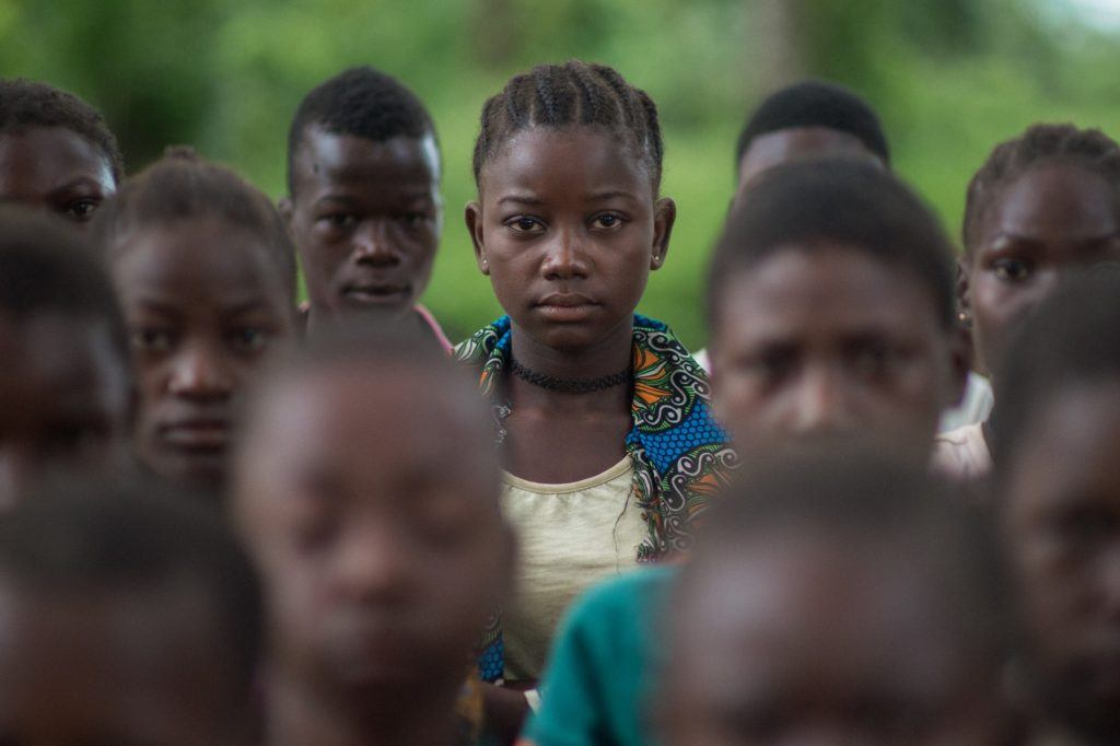 Former Child Soldiers in South Sudan stand next ton one another