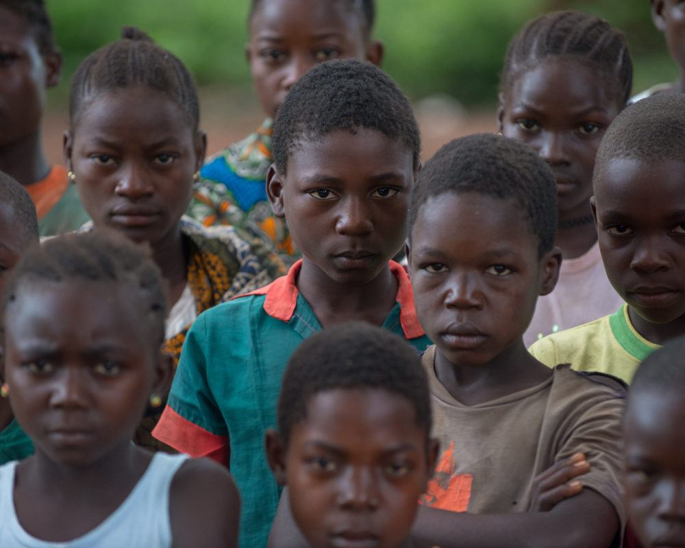 Former child soldiers in South Sudan standing together