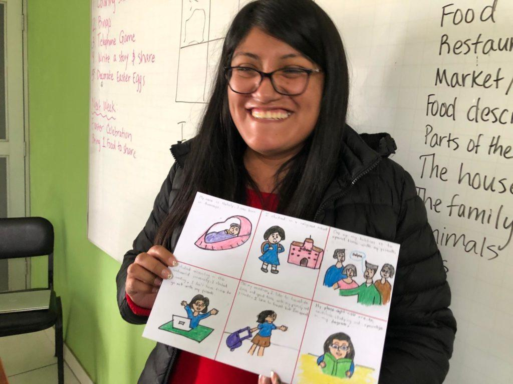 Nataly, a mother in English Class, believes the class will help her in her future. She holds an image she created narrating an english story.
