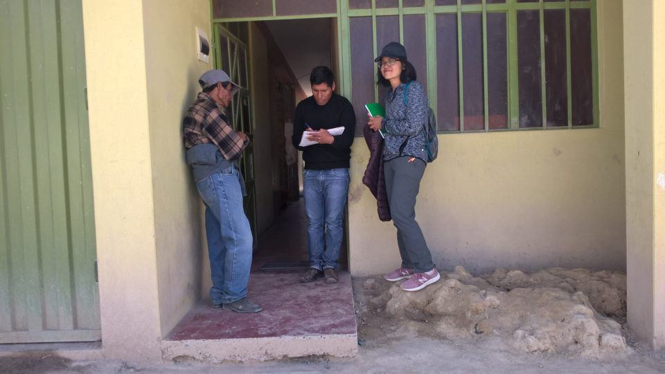 Shandy stands with CMMB staff members in Huancayo, Peru