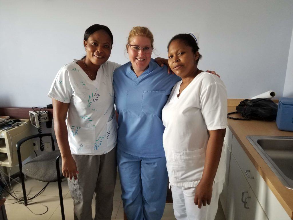 Tracy with two nurses in Haiti