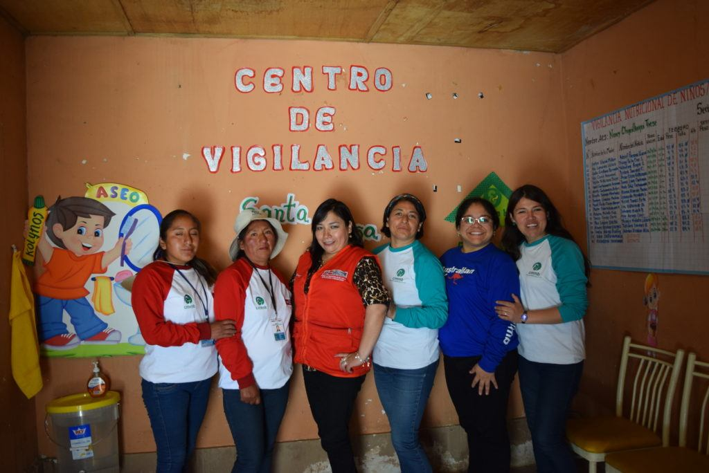 "CMMB staff members stand in front of a wall that says, ""Centro de Vigilancia"""