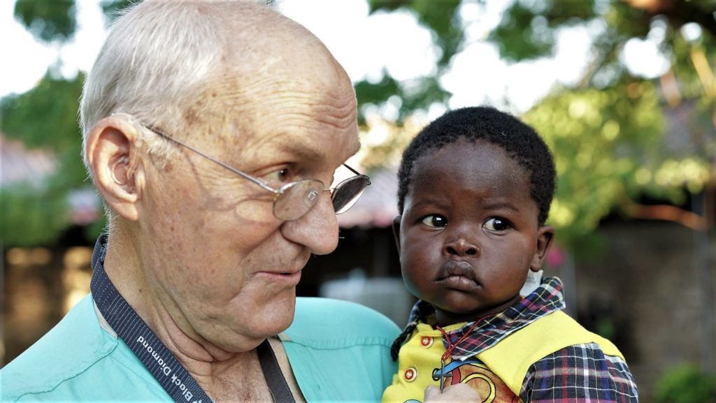 dr jim peck in sudan with baby