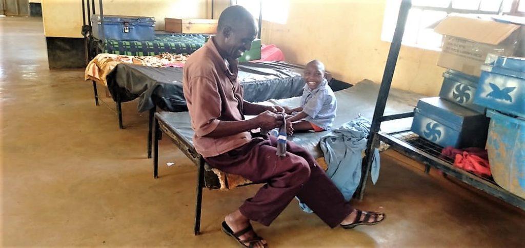 Amos and his nurse David in Kenya