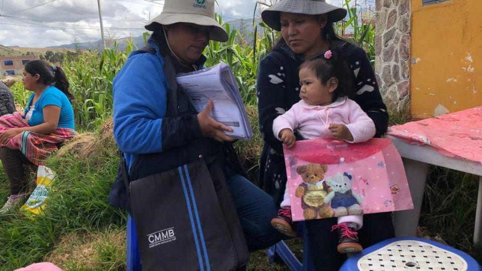 CHW serving a child in Peru