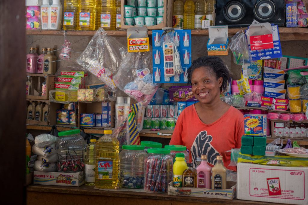Pamela stands in front of her storefront. On international day of the rural woman, we celebrate Pamela