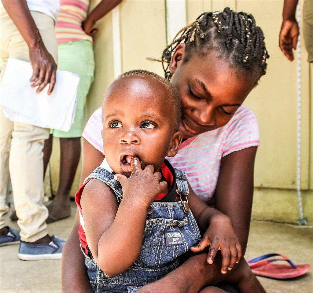 mom with child in haiti batey