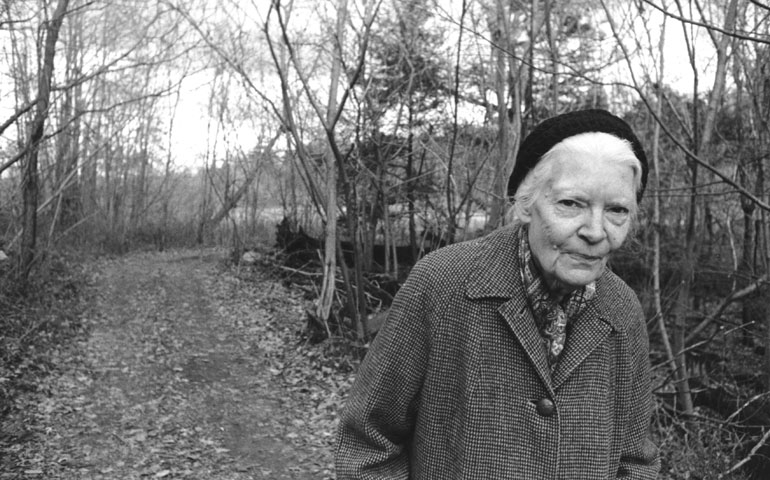 Dorothy Day is a female humanitarian. She walks through the forest in this photo.
