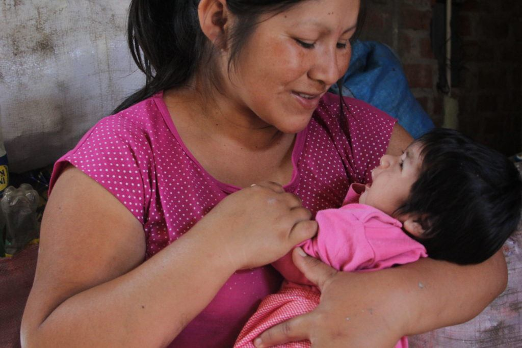 mother and baby in trujillo, peru