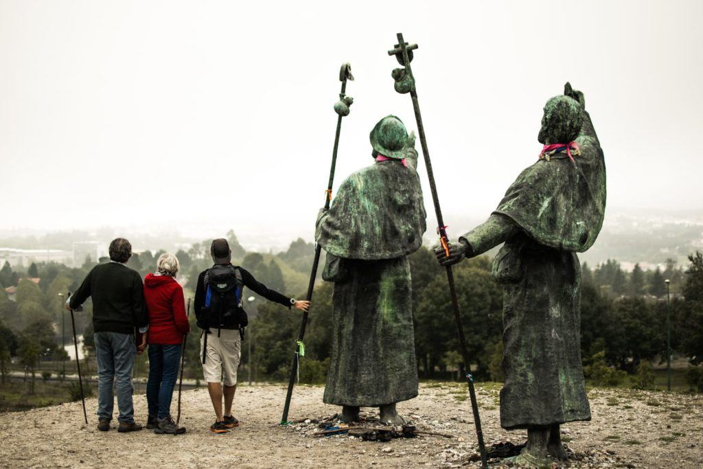 Dr. Matthew Jones stands with his mother and father at Monte do Dozo, a hill overlooking Santiago