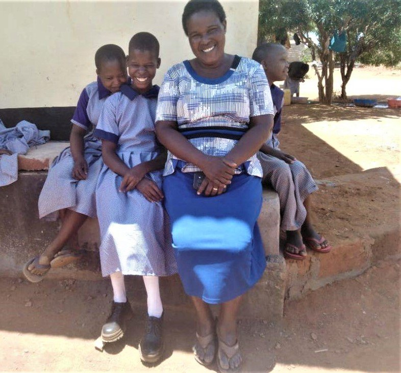 CMMB angel alice with friends and teacher in Kenya