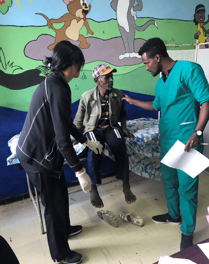 CMANA volunteers with an elderly patient