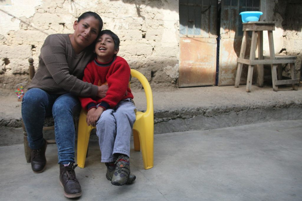 joaquin who has cerebral palsy and his mom in peru