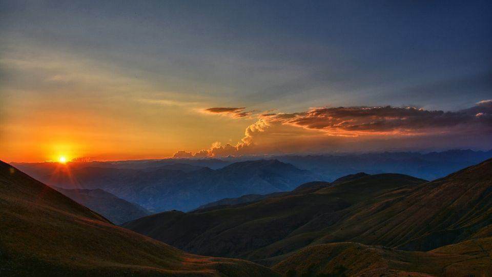 scenic photo of mountains at sunrise