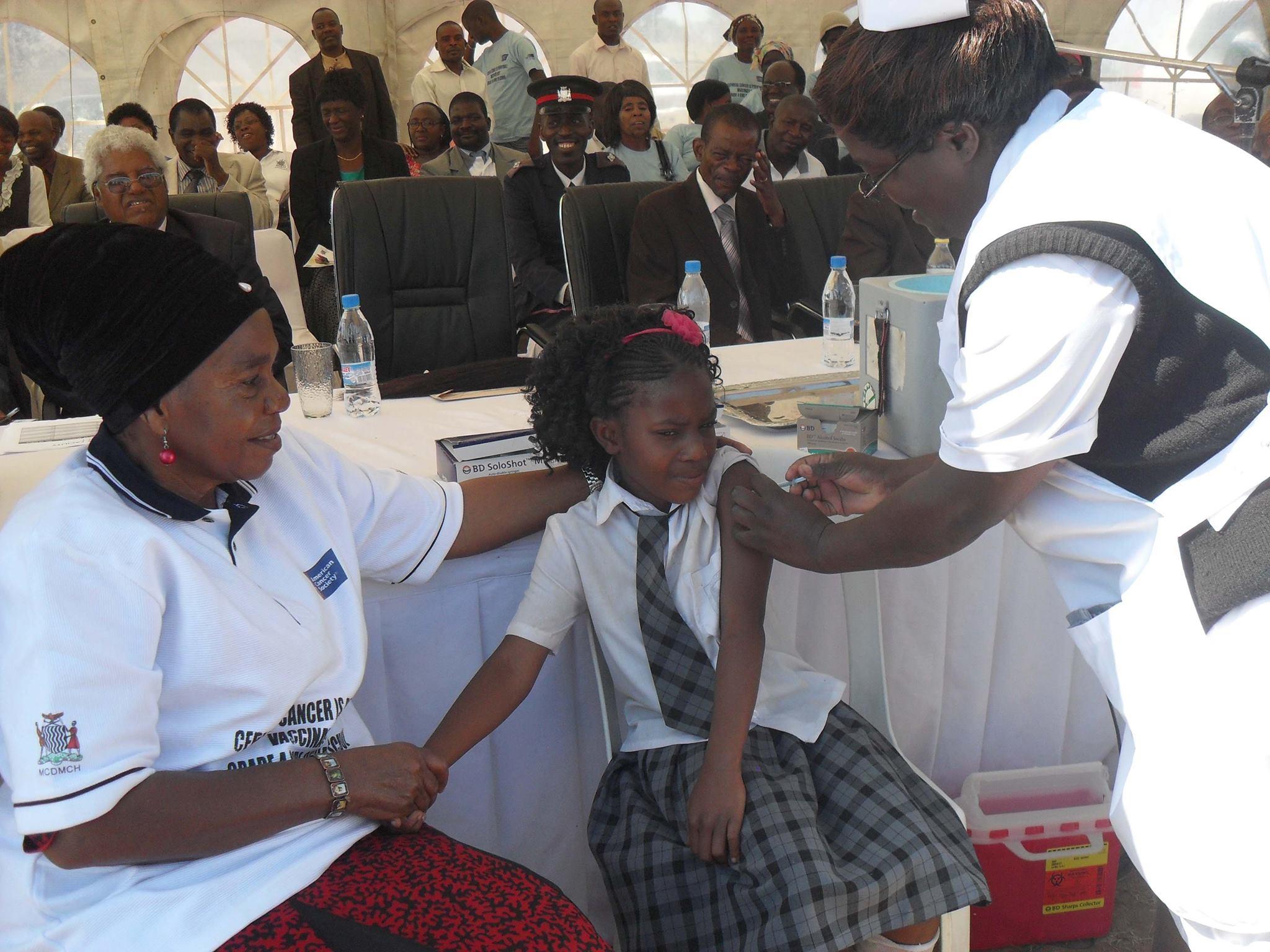 girl gets vaccine