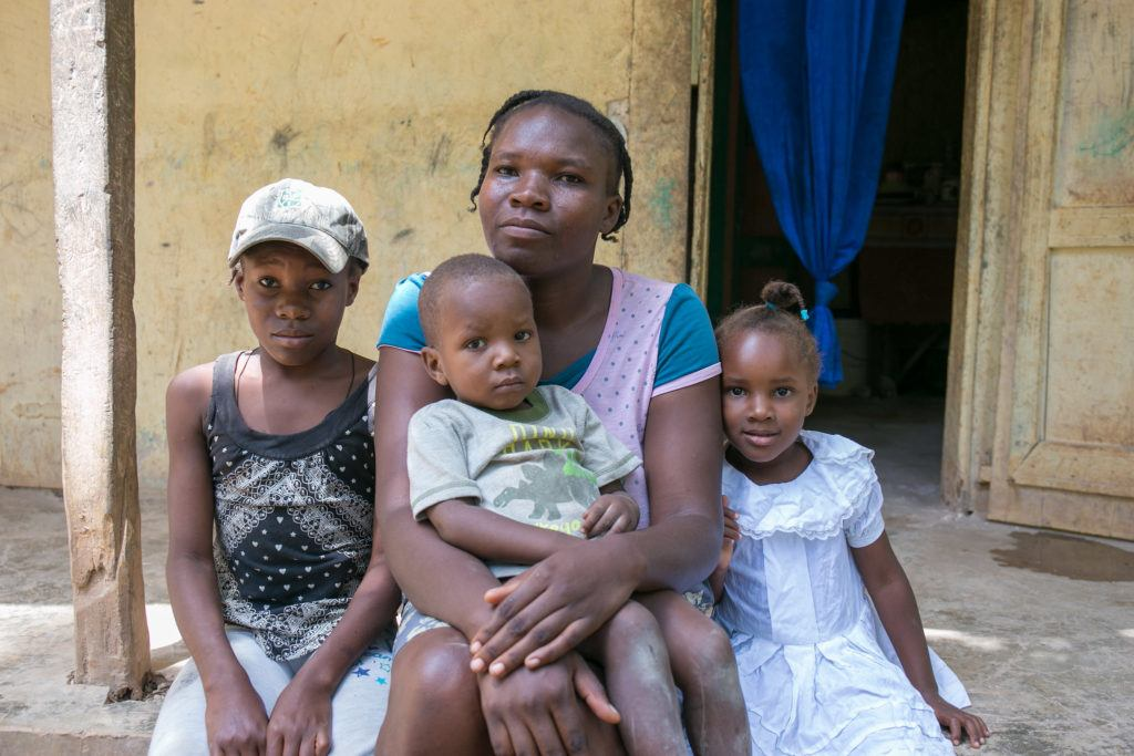A mother sits with her family in Haiti. At CMMB we are celebrating Mother's Day