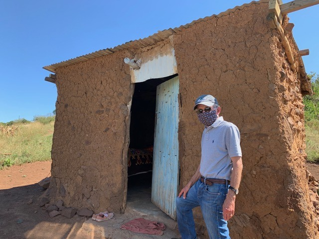 Al Hartmann entering a Swazi homestead during Covid-19