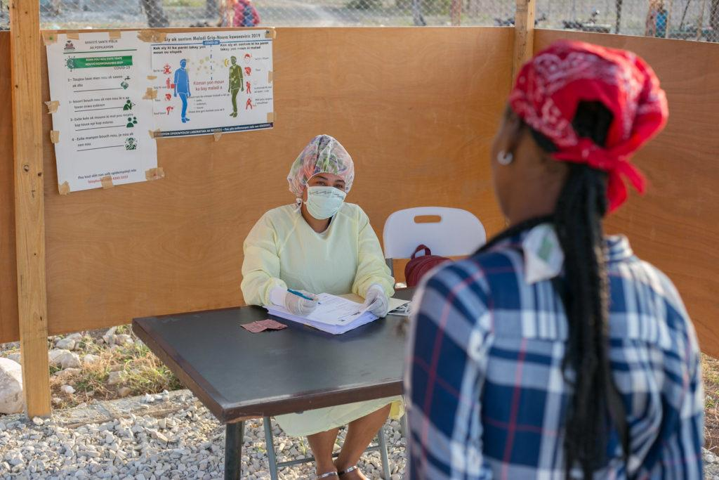 A screening center is set up outside the hospital in Haiti