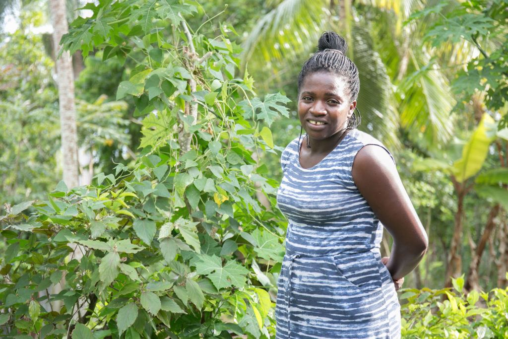 Jossette stands in front of her garden. At CMMB we are celebrating Mother's Day