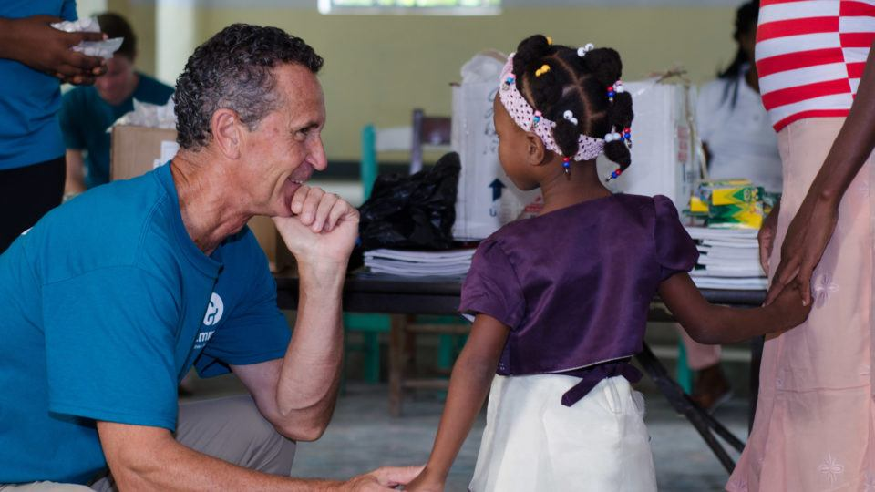 Bruce with a girl in Haiti