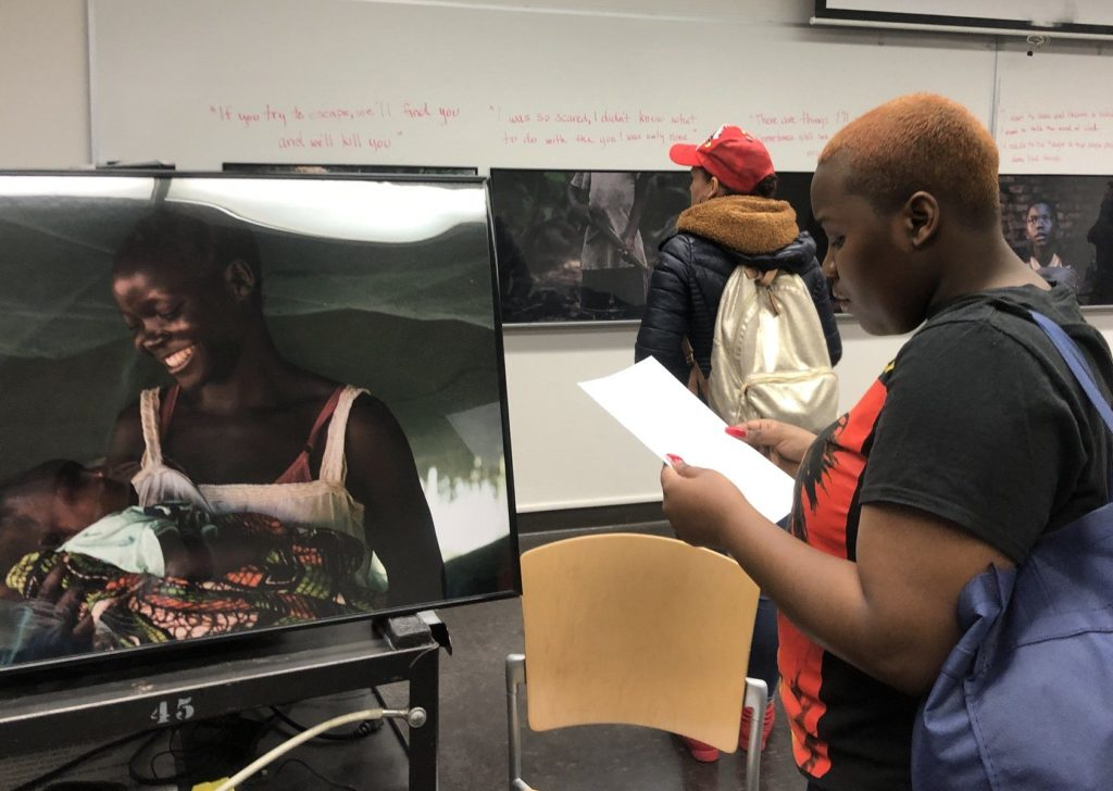 student reading story of nora, former child soldier in south children