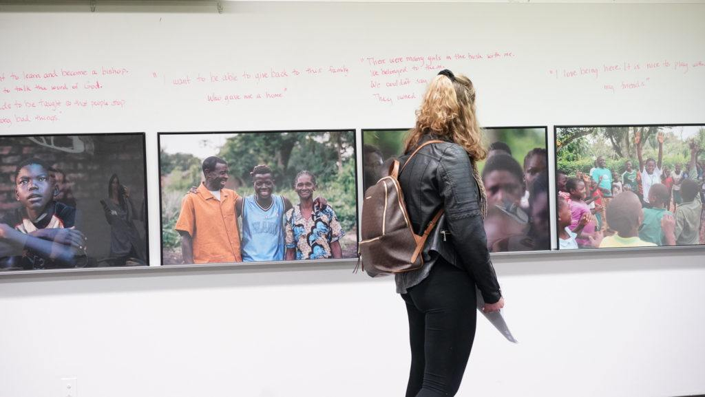 student looking at child soldier images