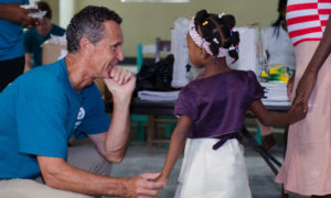 Bruce Wilkinson with Small Girl and Mother in Haiti