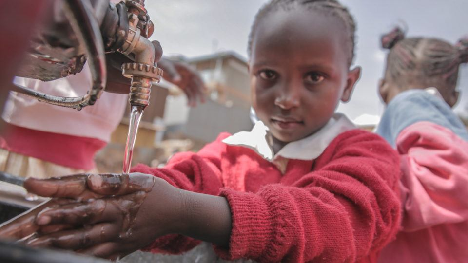 Young Child Washing Hands with Clean Water in Kenya in 2017