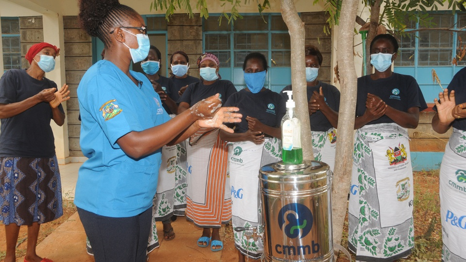 A training with community health workers in Kenya in June 2020 about clean water and sanitation in response to COVID-19.