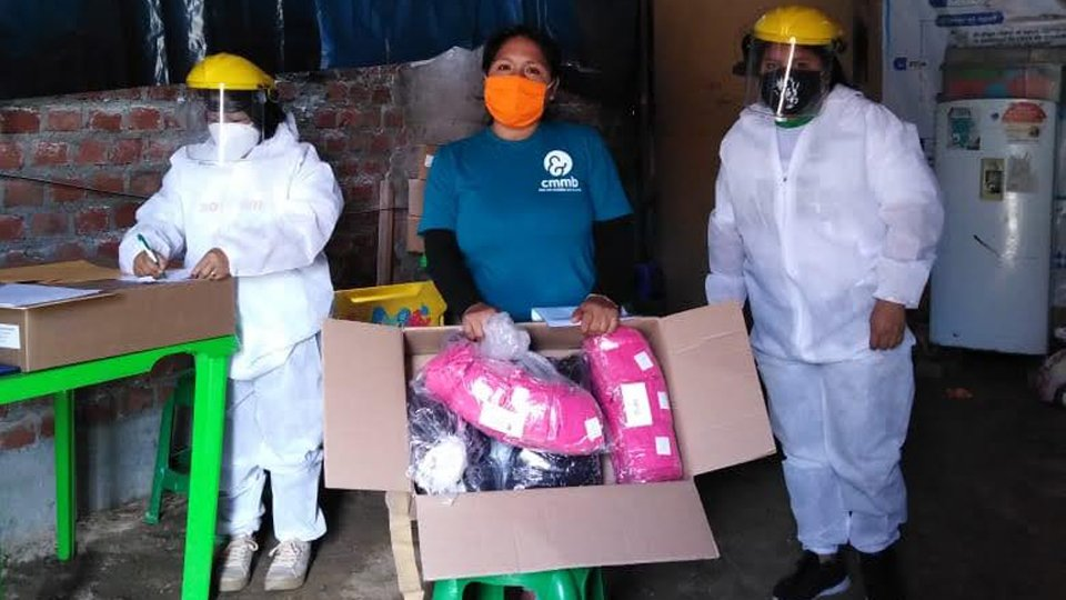 Community heath workers wearing PPE at part of COVID-19 response in Peru in June 2020.