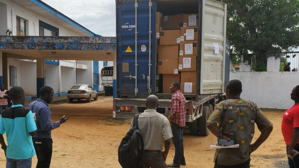 Volunteers unpack medical donations from a truck shipped in Liberia in March 2020