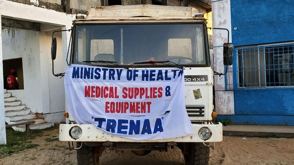 """A ministry of health vehicle with a sign that reads """"medical supplies and equipment"""" in Liberia in March 2020"""