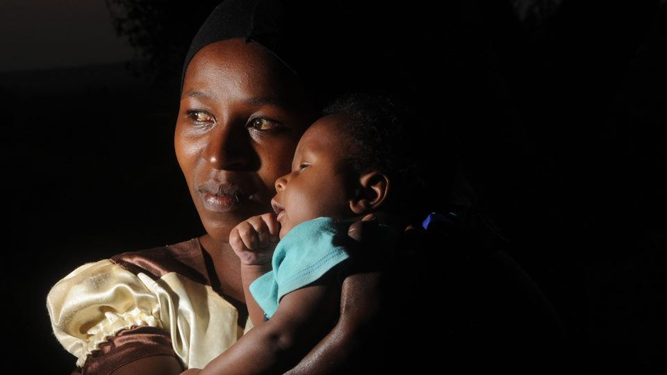 A mother and baby in Kenya in the darkness in June 2020.