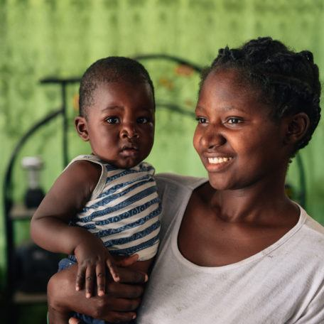 A mother holding her young child in Mwandi, Zambia in October 2019.