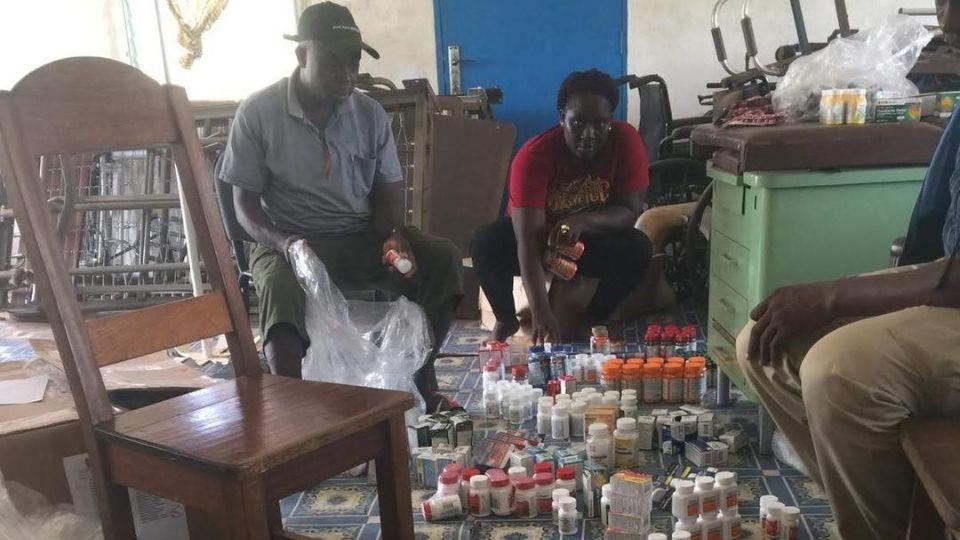 Volunteers sort through donated medicines in Liberia in March 2020