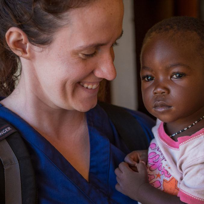 Volunteer Sarah Rubino holding a young girl in South Sudan in October 2018.