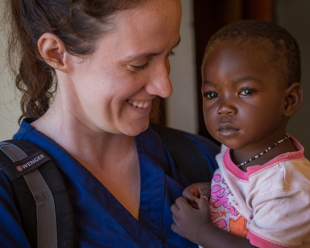 Volunteer Sarah Rubino holding a young girl in South Sudan in October 2018.