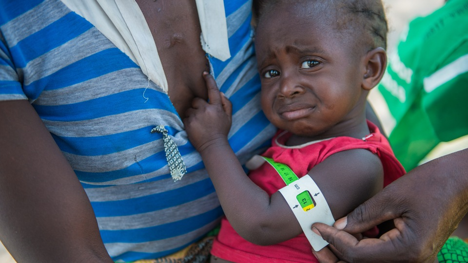 A child's arm being measured for red zone malnutriton in Mwandi in Zambia in October 2019.