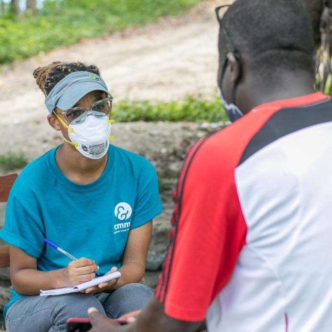 A comunity health worker in Haiti during COVID-19 response in July 2020.